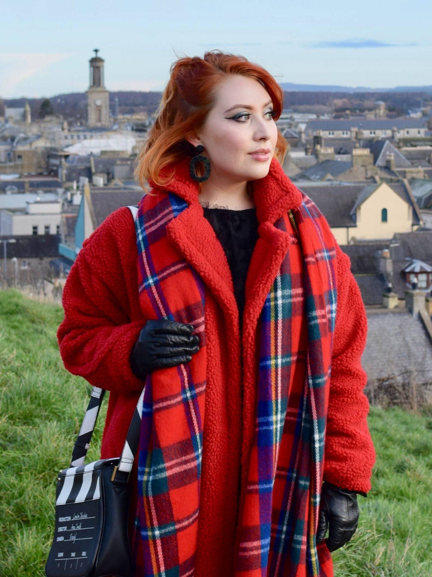 Twenty-Something City cosy winter fashion wearing red coat and tartan blanket scarf