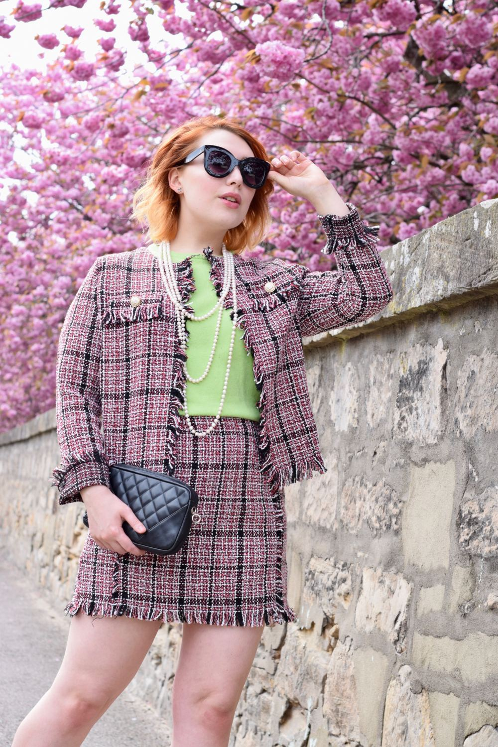 Scottish blogger Styled by Alice wears pink boucle tweed coord, pearls and oversized sunglasses in the style of Chanel