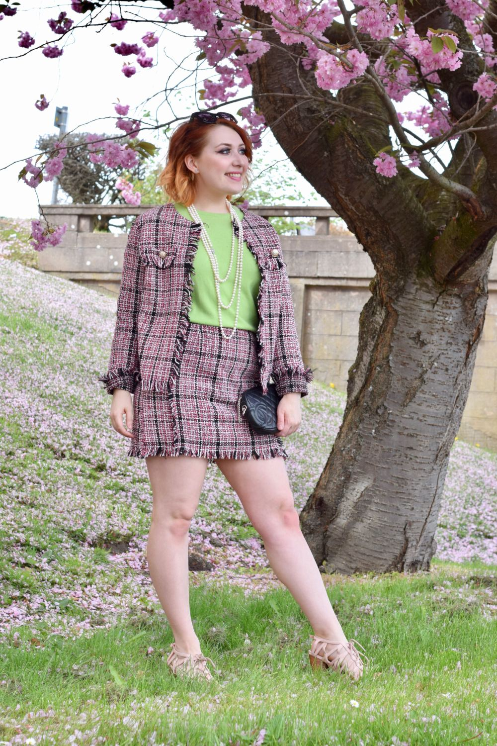 Scottish blogger Styled by Alice wears pink boucle tweed co ord and cashmere jumper, in the style of a classic Coco Chanel suit