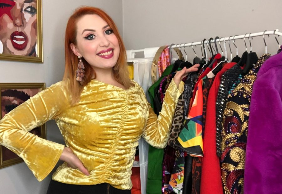 Edinburgh-based wardrobe consultant Alice Cruickshank stands next to a rail of colourful clothes
